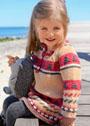 Для девочки 1,5-7 лет. Расклешенное платье с жаккардовыми узорами. Спицы