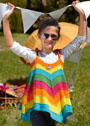 Детский сарафан в разноцветную полоску. Спицы