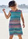 Для девочки 4-14 лет. Летнее расклешенное платье с несложными узорами. Спицы