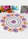 Круглая салфетка с разноцветными цветочными мотивами. Крючок