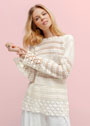 Удлиненный узорный пуловер белого цвета. Крючок