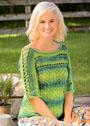 Зеленый пуловер со шнуровкой на рукавах. Крючок