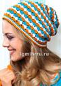 Легкая шапка с цветным ажурным узором в полоску. Крючок