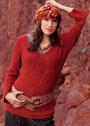 Для полных дам. Темно-красный пуловер с крупным центральным мотивом. Спицы