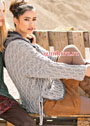Просторный пуловер с плетеным узором и косами. Спицы