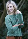 Зеленый шерстяной пуловер с широкими косами. Спицы