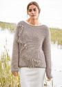 Бежевый пуловер, связанный патентным узором и украшенный кистями. Спицы