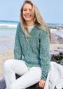 Пуловер мятного цвета с сочетанием узоров. Спицы