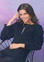 Простой черный пуловер из толстой пряжи. Спицы