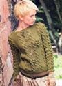 Зеленый пуловер с крупными декоративными узорами. Спицы