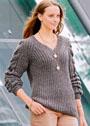 Пуловер с патентными узорами и косами на рукавах. Спицы