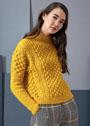 Желтый шерстяной пуловер с узором из шишечек и кос. Спицы