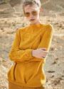 Желтый пуловер с ажурными узорами и складками. Спицы