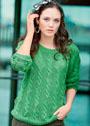 Зеленый пуловер с ажурным узором из кос. Спицы
