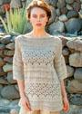 Свободный пуловер цвета грежа с сочетанием узоров. Спицы