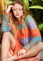 Пуловер с яркими полосами из сквозных узоров. Спицы