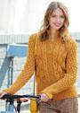 Приталенный шерстной пуловер с миксом узоров. Спицы