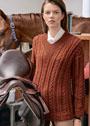 Шерстяной пуловер терракотового цвета с косами. Спицы