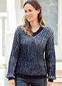 Пуловер с черно-белым патентным узором. Спицы