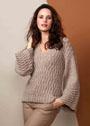 Теплый бежевый пуловер с волнистым узором. Спицы