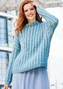 Теплый голубой пуловер с узором из снятых петель. Спицы