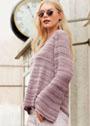 Пуловер А-силуэта с ажурными полосами. Спицы