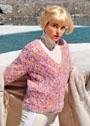 Пуловер с ажурным узором из пряжи в секционных расцветках. Спицы