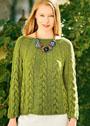 Зеленый пуловер с косами и круглой кокеткой. Спицы