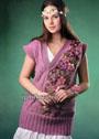 Длинная розовая безрукавка с ажурным узором и великолепной вышивкой из цветов и листьев. Спицы