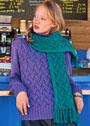 Яркий контраст цвета в пуловере и шарфе с плетеным узором. Спицы
