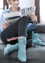Теплые зеленые носки с ажурным узором. Спицы