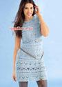 Голубое узорчатое платье с короткими рукавами. Спицы