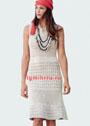 Светло-бежевое летнее платье с миксом фантазийных узоров. Спицы
