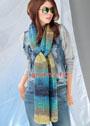 Длинный разноцветный шарф, связанный спицами разной толщины. Спицы