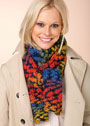 Пестрый шарф из толстой пряжи секционного крашения. Спицы