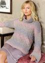 Свободный свитер с узором из ромбов. Спицы