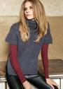 Теплый свитер с приспущенными плечами и высокими боковыми разрезами. Спицы