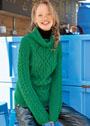 Зеленый чистошерстяной свитер с миксом узоров. Спицы