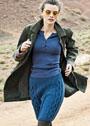 Синяя шерстяная юбка с узорами из сот и кос. Спицы